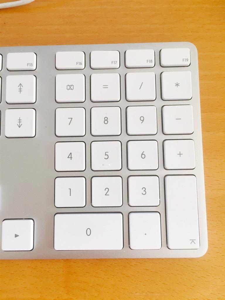 Re: How to change the decimal point on the numeric keypad to a comma