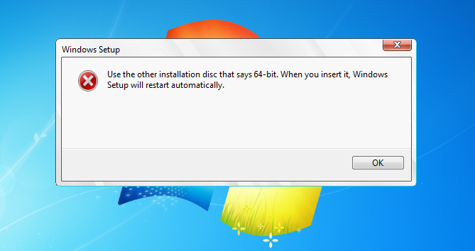 Use the other installation disc that says 64-bit  When you insert