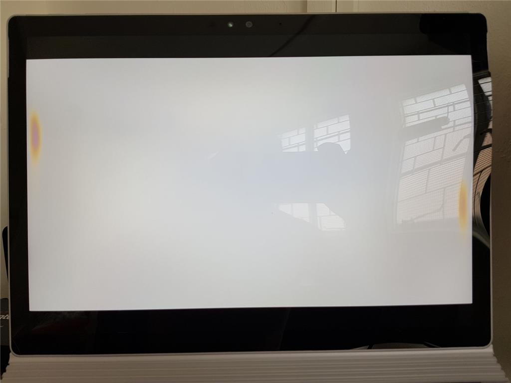 Surface Screen Has Red And Yellow Burn Marks And Is Now