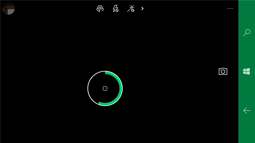 Camera taking a photo with timer indicator. Screenshot.
